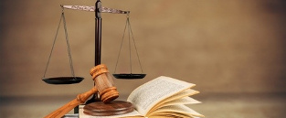 Gavel, book and scales of justice at law school